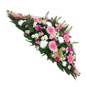 Joli camaïeu de rose pour cette magnifique raquette de fleurs de saison. La couleur rose exprime l'innocence, la douceur et le romantisme.